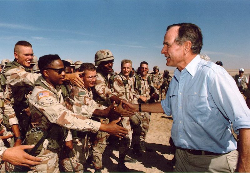 President Bush visiting American troops in Saudi Arabia on Thanksgiving Day, 1990 (public domain)